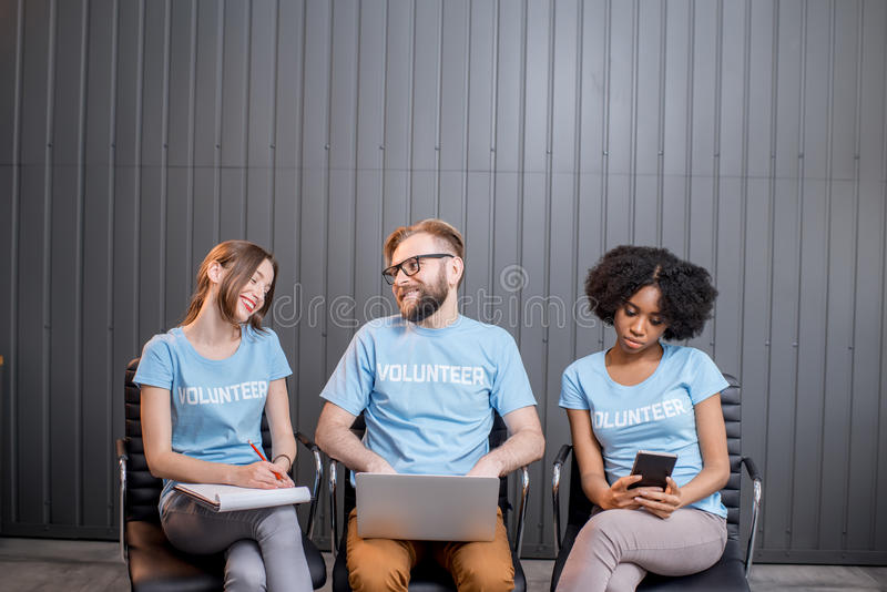 Volunteers working at the office stock photos