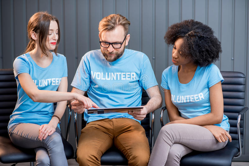 Volunteers working at the office stock image