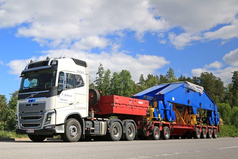 Volvo FH16 750 Semi Transports Shipyard Crane Bogie. PAIMIO, FINLAND - JUNE 4, 2016: White Volvo FH16 750 transports shipyard crane bogie on trailer. The 48 stock photo