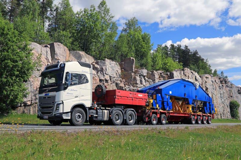 Volvo FH16 750 Semi Transports Shipyard Crane Component. PAIMIO, FINLAND - JUNE 4, 2016: Volvo FH16 750 semi transports shipyard crane component. The 48-tonne stock photography