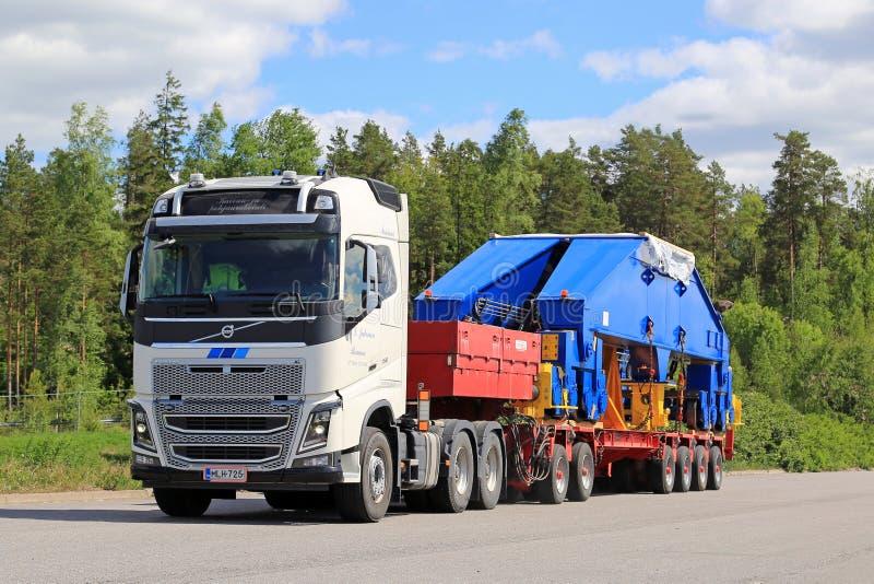 Volvo FH16 750 Semi Transports Shipyard Crane Component. PAIMIO, FINLAND - JUNE 4, 2016: White Volvo FH16 750 transports shipyard crane bogie on trailer. The 48 stock photos
