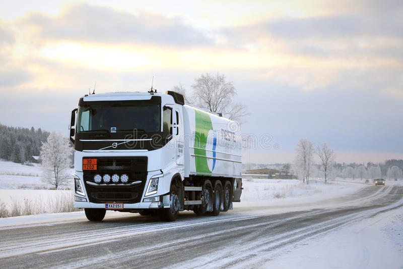 Volvo FH Tank Truck Hauls Diesel Fuel in Winter. SALO, FINLAND - JANUARY 16, 2016: Volvo FH tank truck of Neste hauls diesel fuel in South of Finland on a cold royalty free stock photography