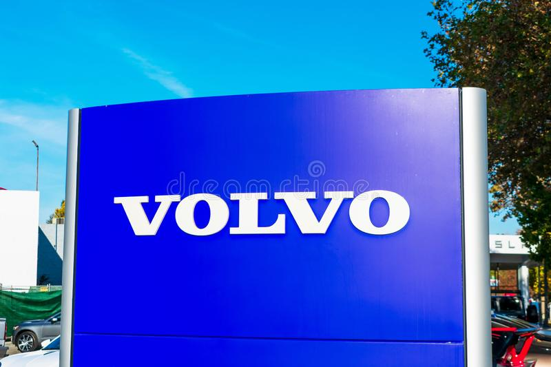 Volvo sign and logo at Swedish automotive manufacturer dealership royalty free stock photo