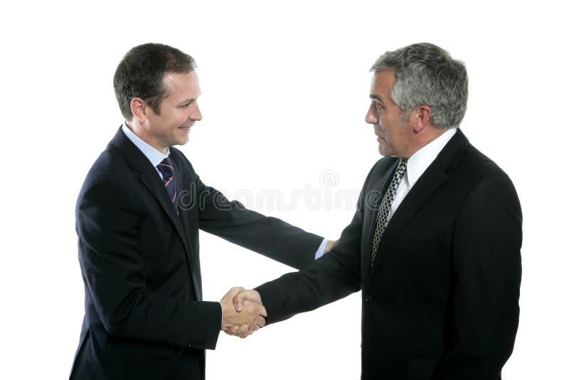 Volwassen de deskundigheidsportret van de zakenmanhanddruk stock foto's