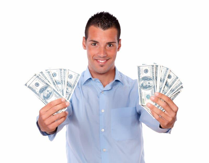 Volwassen knappe kerel die zijn contant geld houden royalty-vrije stock foto's