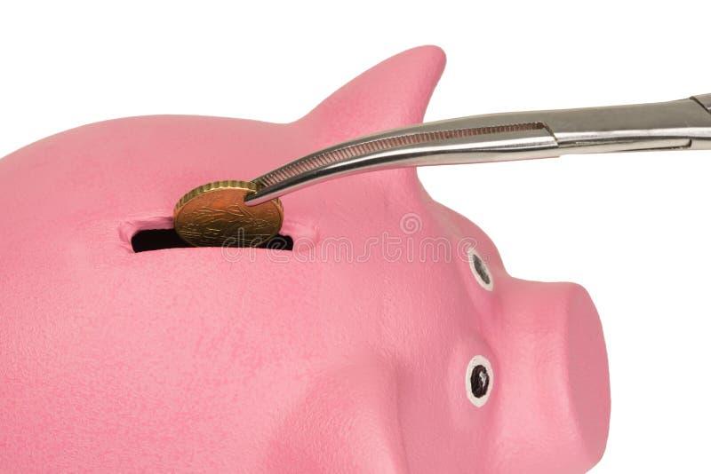 Vom Sparschwein erhalten Sie Münzen von oben lizenzfreie stockfotos