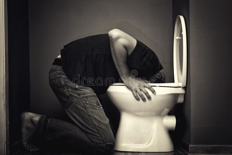 Vomissement d'homme photos stock