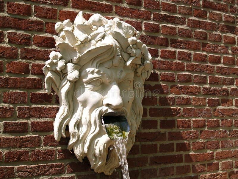Vomitar do deus da água fotografia de stock
