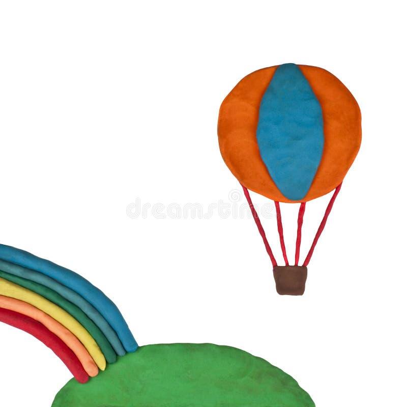 Voo do balão da massa de modelar sobre o arco-íris imagens de stock royalty free