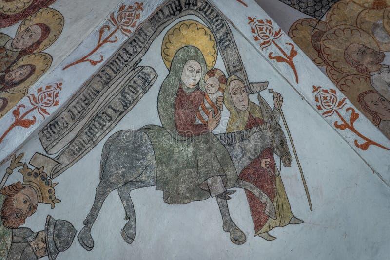 Voo em Egito, família santamente que corre de Herod, uma pintura mural antiga fotos de stock