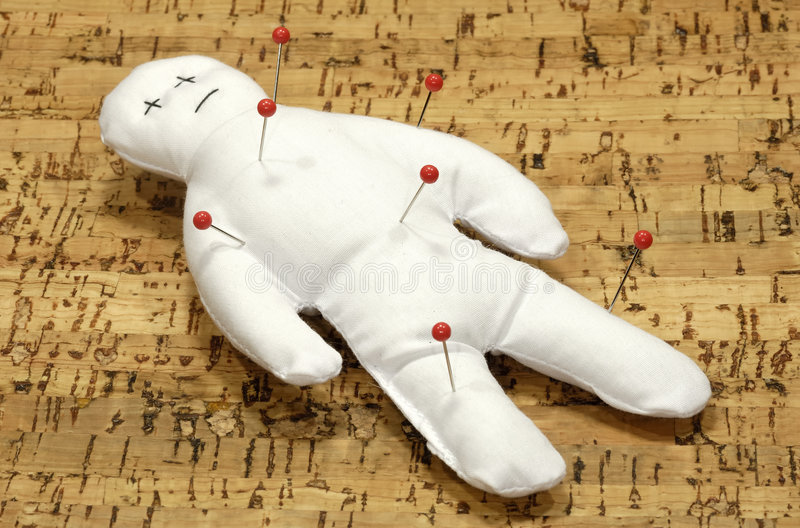 Voodoo. A Voodoo Doll With Pins stock photos