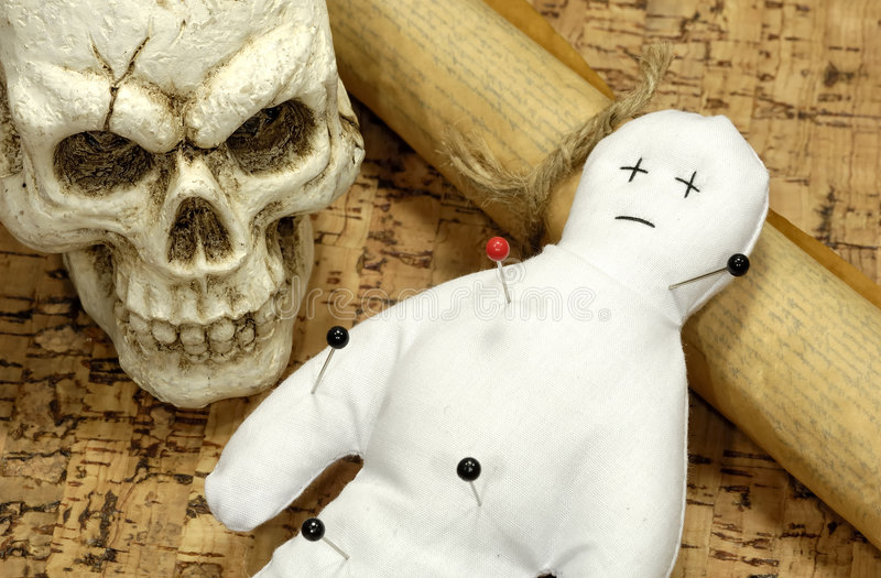 Voodoo. Doll, Skull and Scroll -  Concept stock image