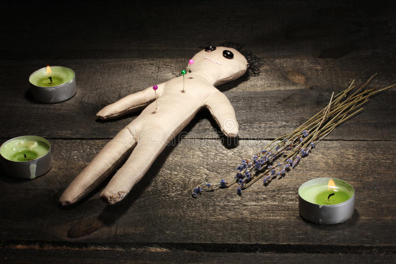 Voodoo doll boy. On a wooden table in the candlelight royalty free stock photography