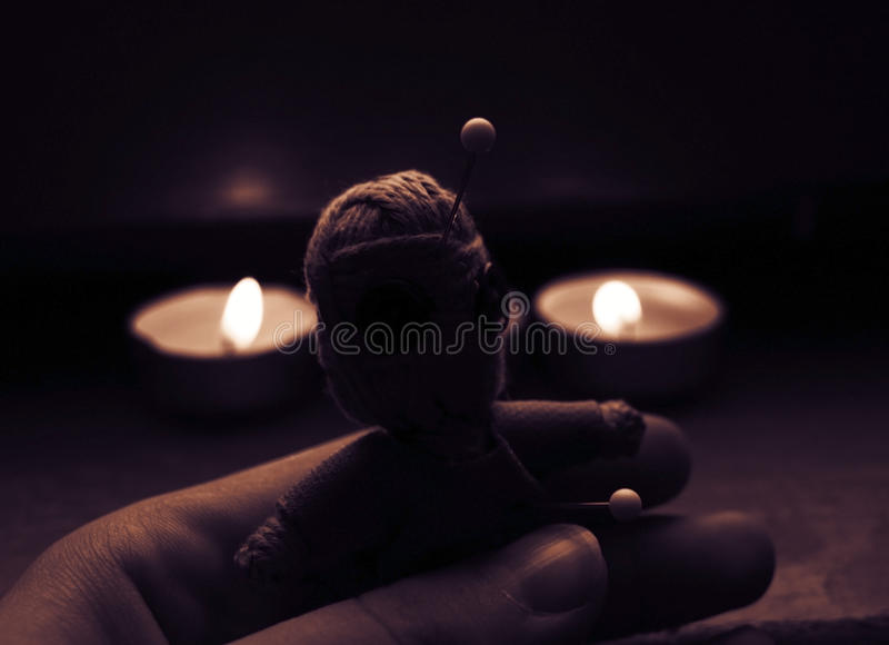 Voodoo doll in hand stock photo
