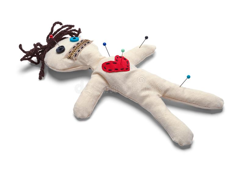 Voodoo Doll. With Needles Isolated on White Background royalty free stock photo