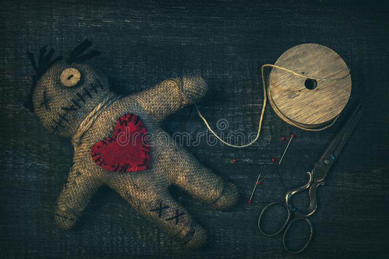 Voodoo doll with pins stock image