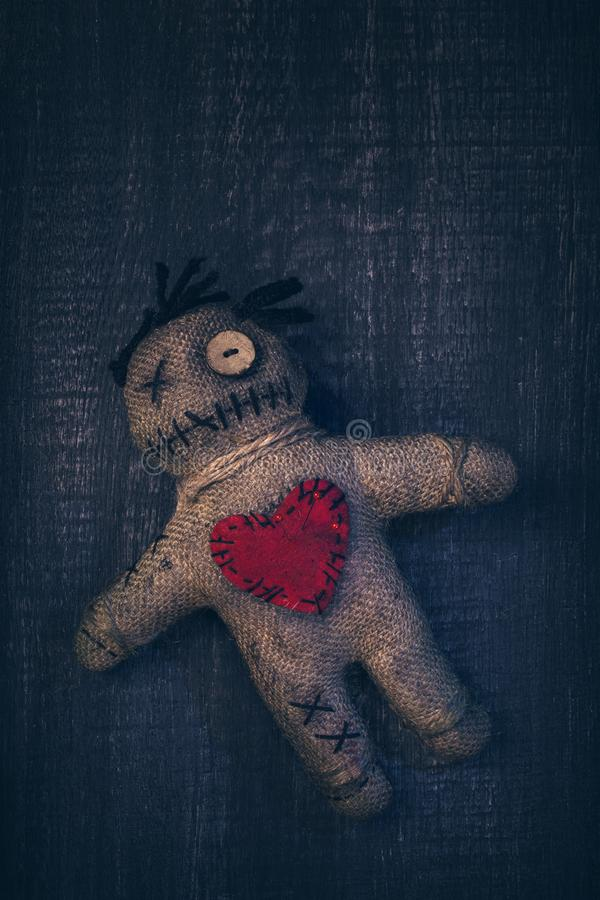 Voodoo doll with pins. Stuck into it stock photo