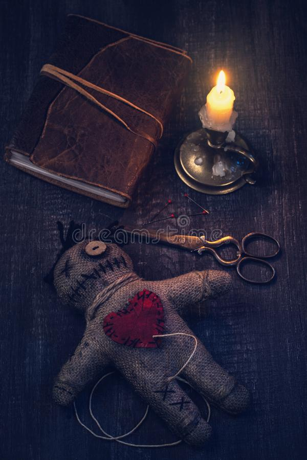 Voodoo doll with pins. Stuck into it royalty free stock photography