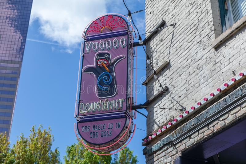 Voodoo doughnuts neon sign on the building in downtown Portland stock photography