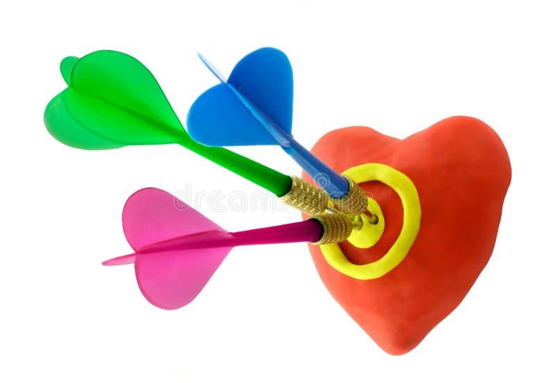 Voodoo heart. Darts heart. Arrows of Cupid royalty free stock photography