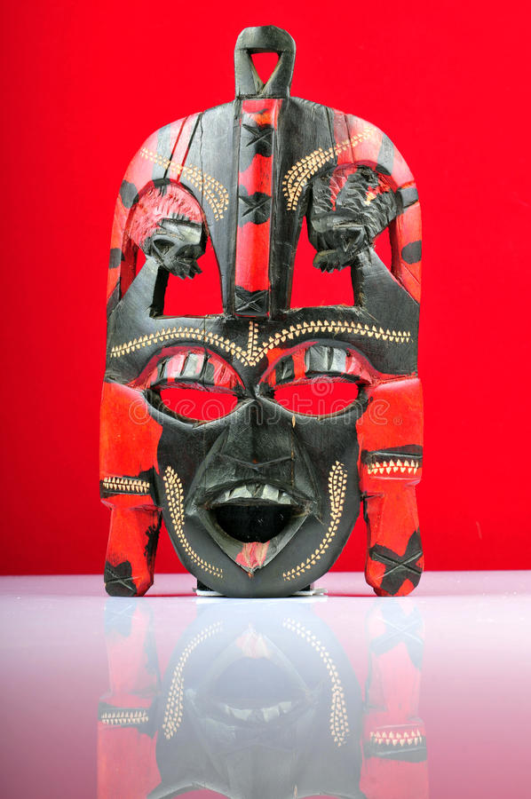 Voodoo mask. Isolated on red background stock photography
