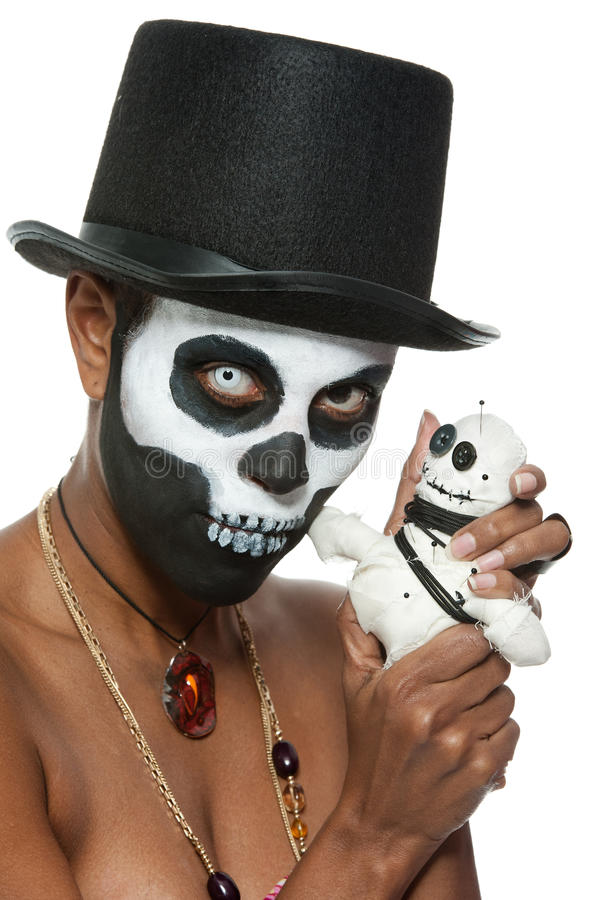Voodoo priestess. A female voodoo priestess with face paint stock image
