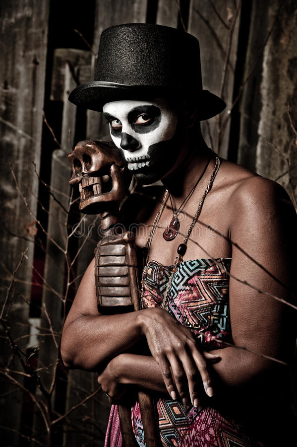 Voodoo priestess. A female voodoo priestess with face paint royalty free stock images