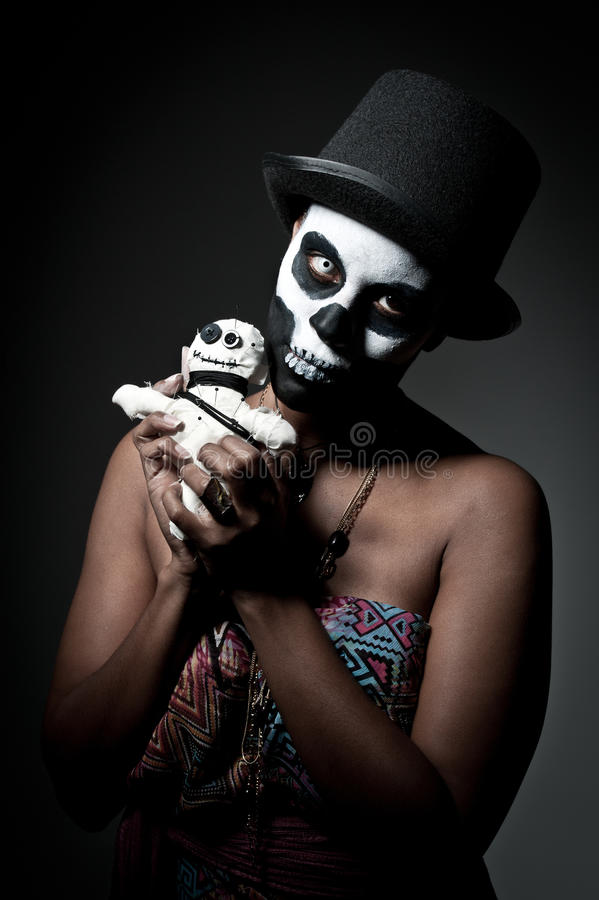 Voodoo priestess. A female voodoo priestess with face paint royalty free stock photo