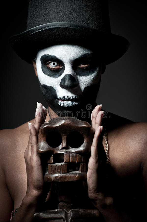 Voodoo priestess. A female voodoo priestess with face paint royalty free stock image