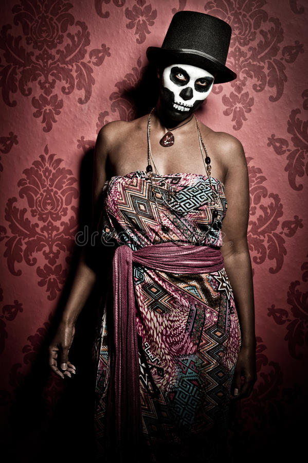 Voodoo priestess. A female voodoo priestess with face paint stock photo