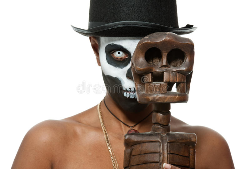 Voodoo priestess. A female voodoo priestess with face paint royalty free stock photography