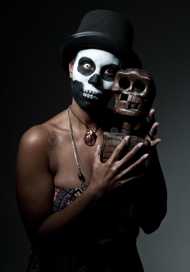 Voodoo priestess. A female voodoo priestess with face paint stock photography