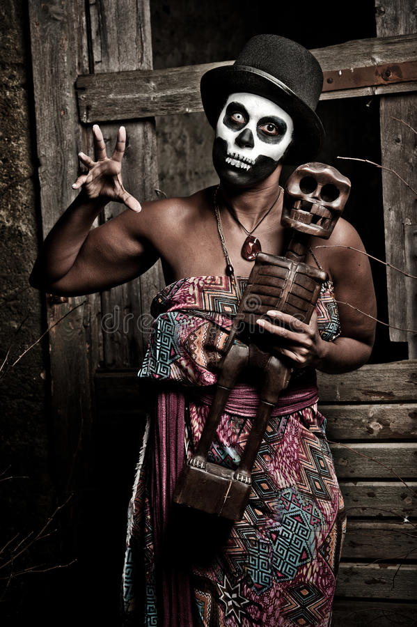 Voodoo priestess. A female voodoo priestess with face paint stock photos