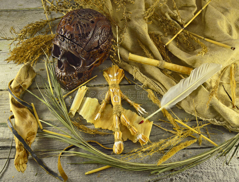 Voodoo still life 2. Halloween voodoo still life with skull, straw doll and quill pen with blood stock images