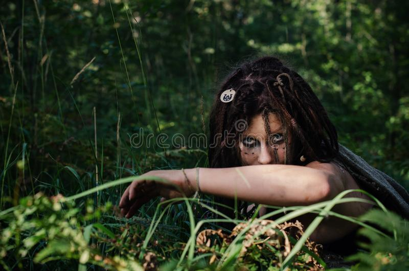 Voodoo witch in the woods. Evil and dirty. Hides in the woods royalty free stock photography