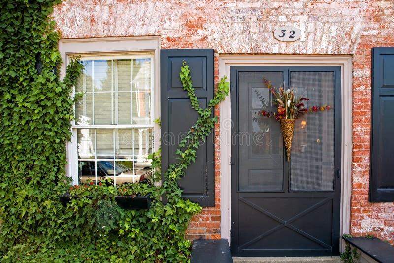 Front Door van Baksteenhuis royalty-vrije stock afbeeldingen