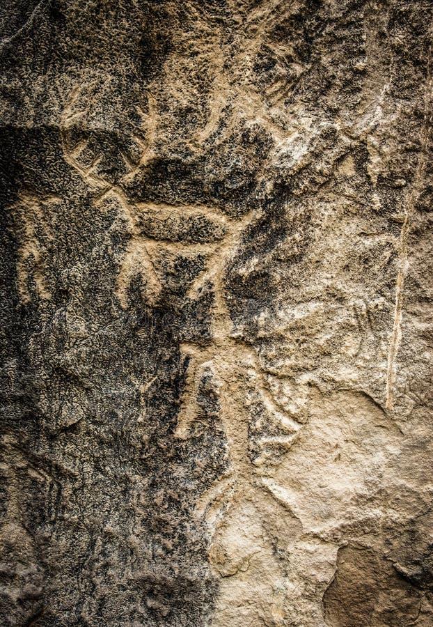 Voorhistorische rots snijdende rotstekeningen in Gobustan royalty-vrije stock afbeeldingen