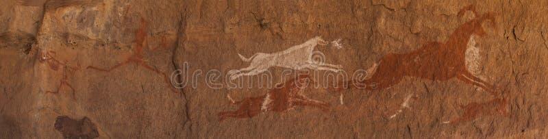Voorhistorische Rotstekeningen in de libian woestijn van de Sahara royalty-vrije stock fotografie