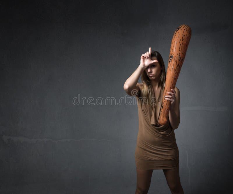 Voorhistorische vrouw l voor verliezer stock foto's
