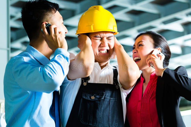 Voorman, Manager en verschuivingssupervisor in fabriek royalty-vrije stock afbeeldingen
