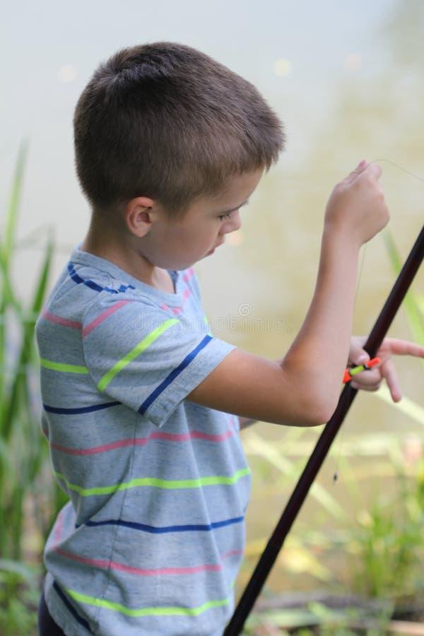 Voorraadfoto van weinig jongen visserij royalty-vrije stock foto