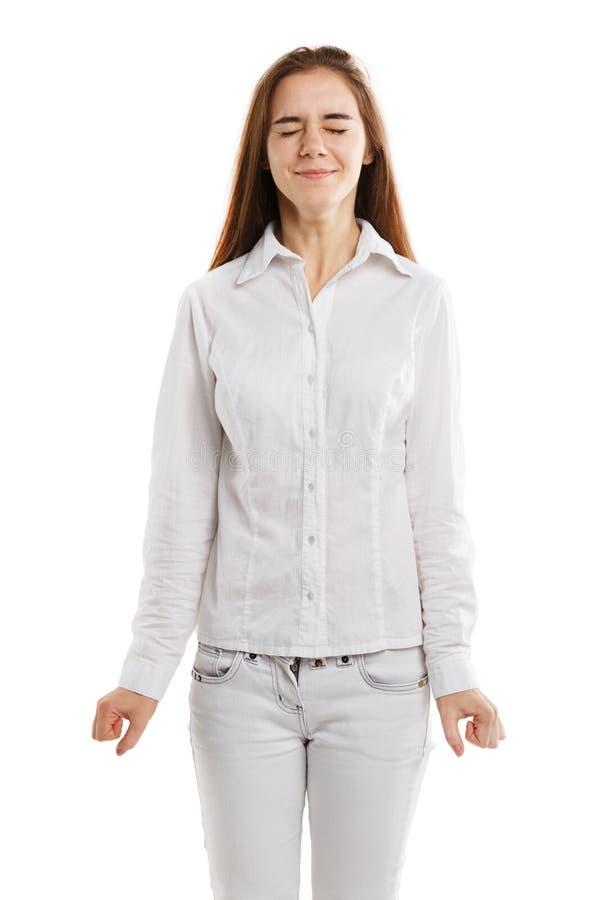 Vorbildliche Aufstellung des schönen Mädchens mit den Händen lokalisiert auf einem weißen Hintergrund stockbild