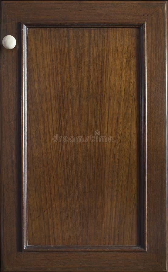 Vordere Holzrahmen-Schranktür der Küche stockbild