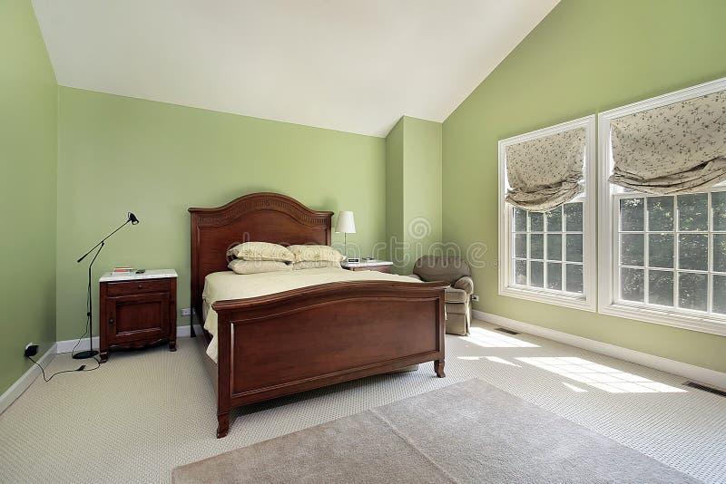 Vorlagenschlafzimmer mit greenwalls stockfotografie