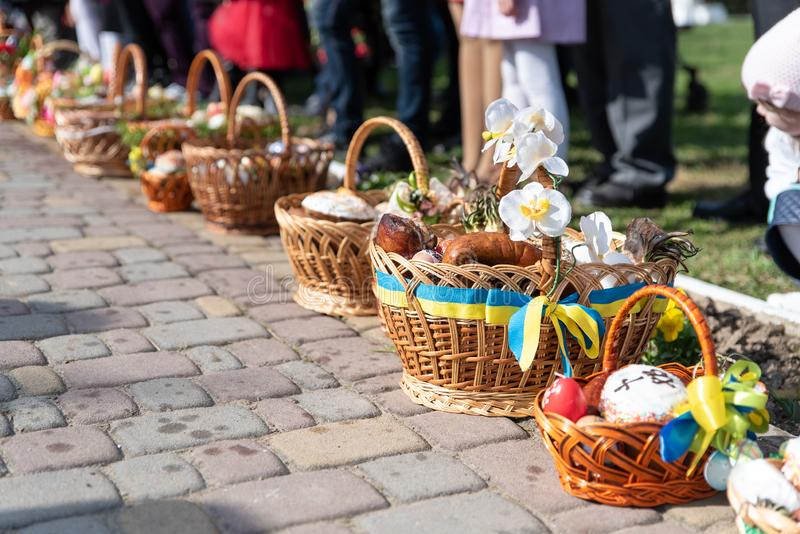 Voroblevychi village, Drohobych district, Ukraine - April 07, 2018: Easter baskets with food near church. Voroblevychi village, Drohobych district, Western stock photos