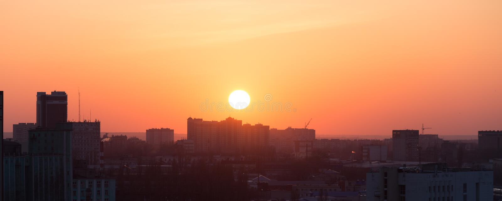 Voronezh city at sunset, against a colorful sky, panoramic aerial view from roof stock image
