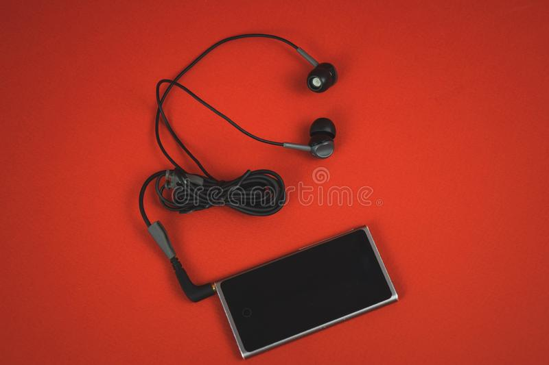 VORONEZH, RUSSIA - 30 april, 2019: New audio player iPod and headphones unpacked in the first day after buying. Produced by Apple royalty free stock photos
