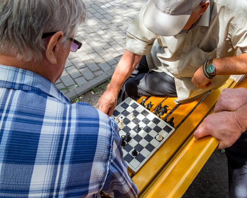 Chess game takes place on the street bench stock image