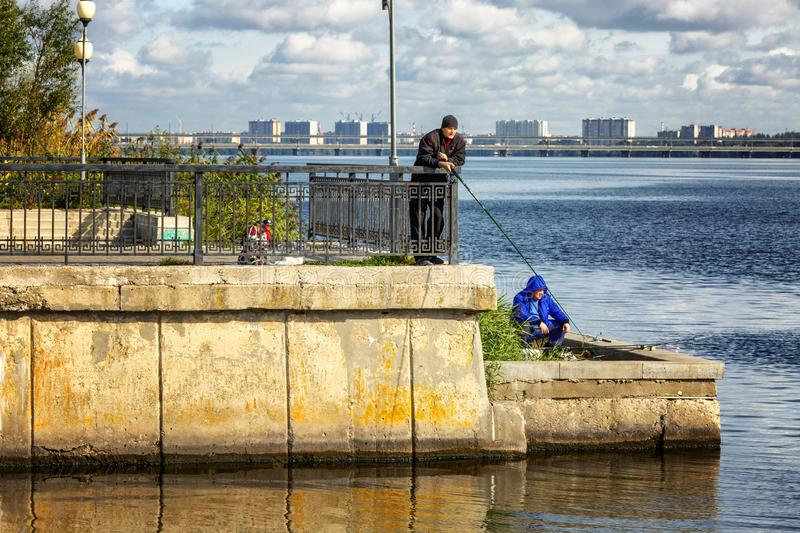 Voronezh, Russia, 09/24/2016: Fishermen catch fish on the city embankment stock photos