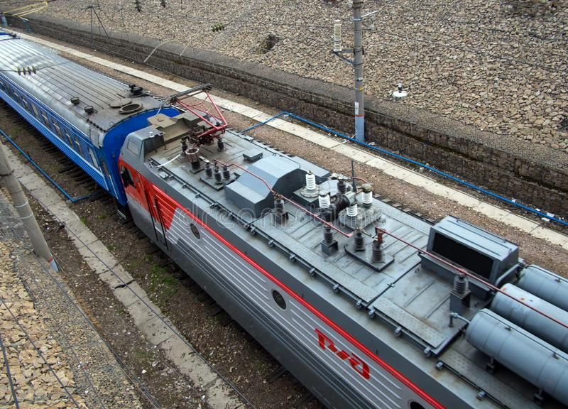 Electric locomotive RZD carries a passenger train, a top view stock image